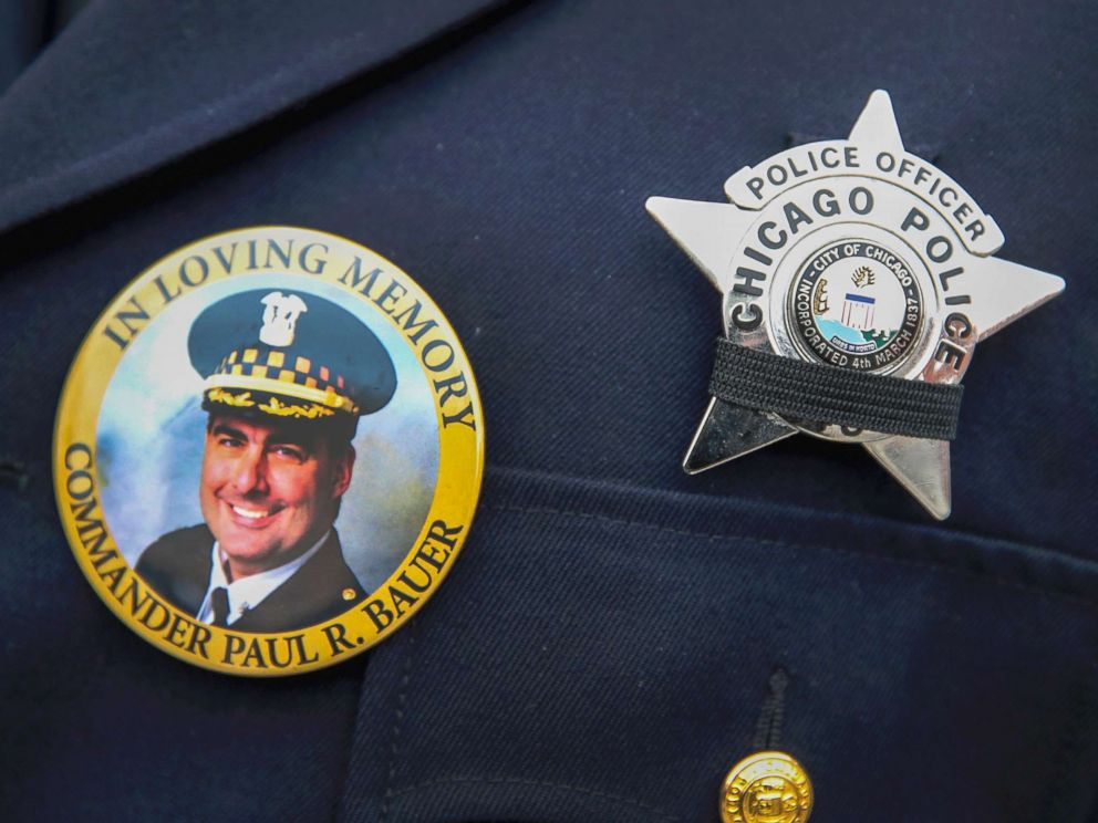 PHOTO: A photograph of Chicago police Commander Paul Bauer is seen on a pin that a Chicago police officer wears as he stands outside of the Nativity of Our Lord church in the Bridgeport neighborhood where Bauers funeral was held Feb. 17, 2018.