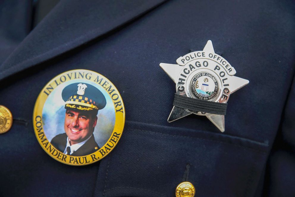 A photograph of Chicago police Commander Paul Bauer is seen on a pin that a Chicago police officer wears as he stands outside of the Nativity of Our Lord church in the Bridgeport neighborhood where Bauer's funeral was held Feb. 17, 2018.
