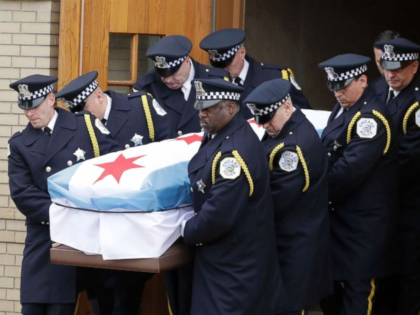 Thousands grieve for slain Chicago police commander