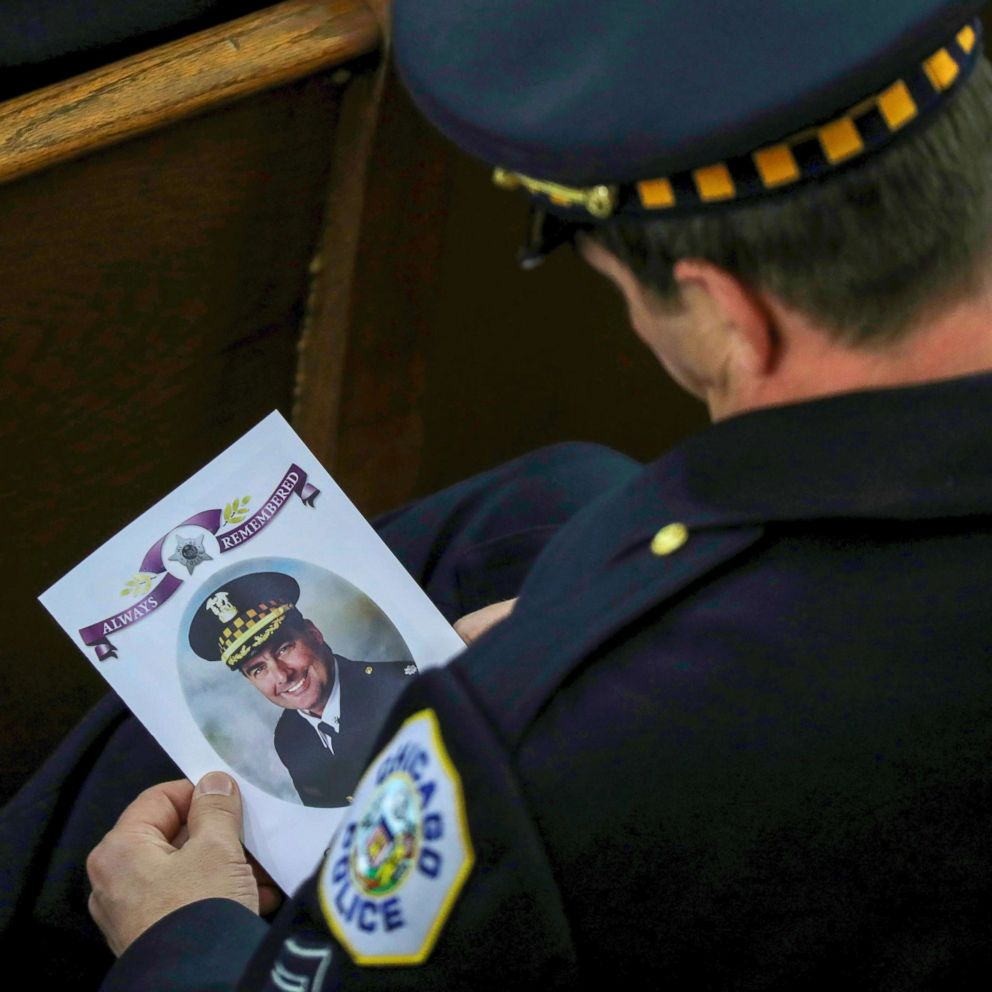 PHOTO: An 18th District officer holds the program for the funeral mass of Chicago police Commander Paul Bauer at Nativity of Our Lord Catholic Church, Feb. 17, 2017, in Chicago.