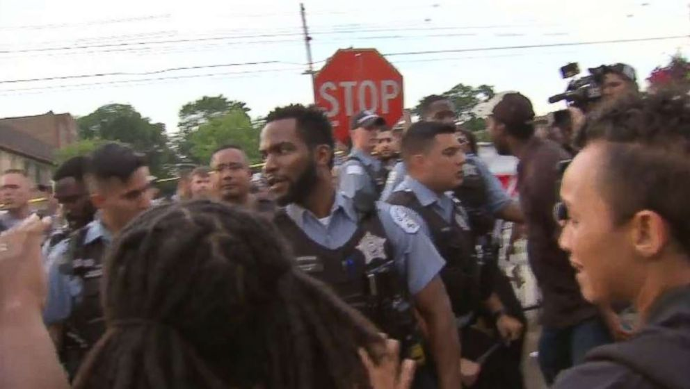 Protesters sparred with Chicago police officers following a deadly shooting on Saturday