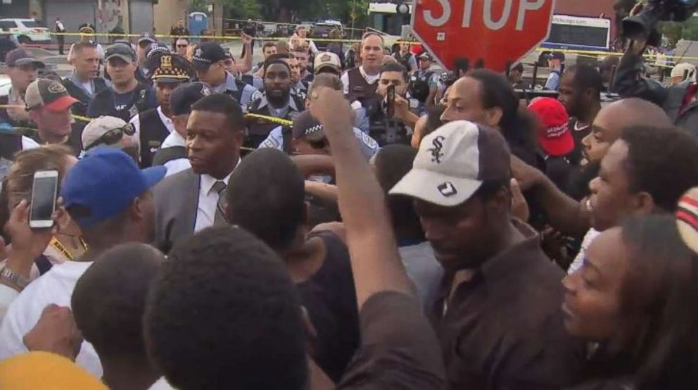 Protesters clash with police after man shot by officer in Chicago
