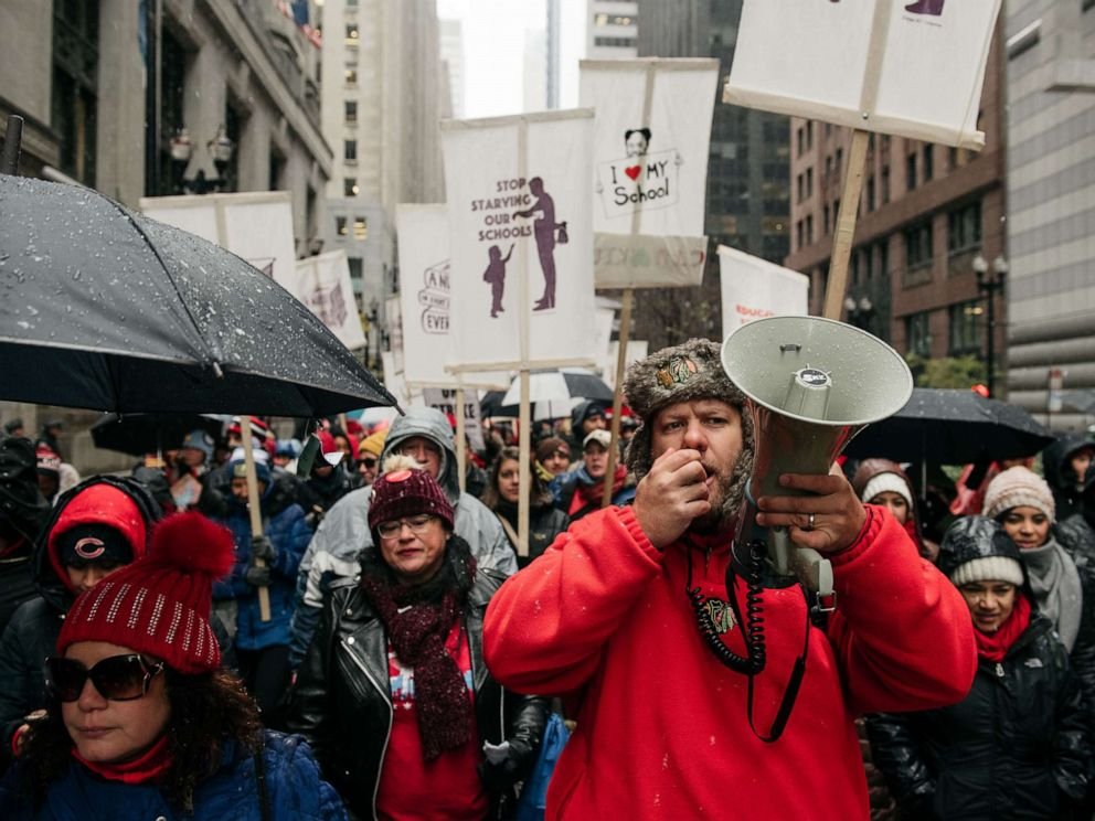 PHOTO: Braving snow and cold temperatures, thousands marched through the streets near City Hall during the 11th day of an ongoing teachers strike, Oct. 31, 2019, in Chicago, Illinois.