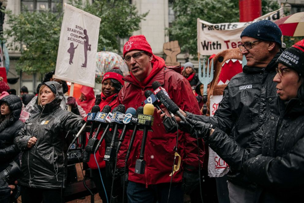 PHOTO: Chicago Teachers Union president Jesse Sharkey holds a press conference moments before a march through the streets near City Hall during the 11th day of an ongoing teachers strike, Oct. 31, 2019, in Chicago, Illinois.