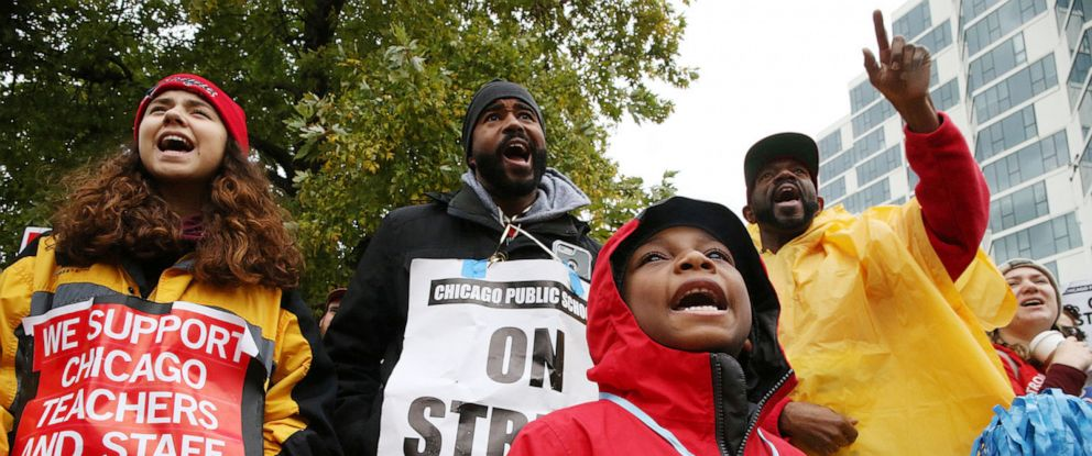 "CPS student, Bryce Kelley, 7, listens to speakers following a march by Chicago Teachers Union members and supporters through the streets of Chicagos Hyde Park neighborhood during the ""Nurse in Every School"" Solidarity March for Justice, Oct. 21, 2019."