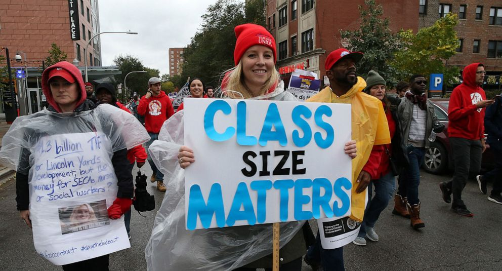 PHOTO: Chicago Teachers Union members and supporters march through the streets of Chicagos Hyde Park neighborhood during the Nurse in Every School Solidarity March for Justice, Oct. 21, 2019.
