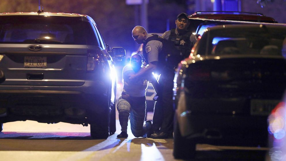 PHOTO: A Chicago police officer attempts to comfort the relative of a fatal gunshot victim as she grieves in the 4700 block of West Jackson Boulevard, Sept. 29, 2017. A 40-year-old man was found fatally shot on the sidewalk, according to police.