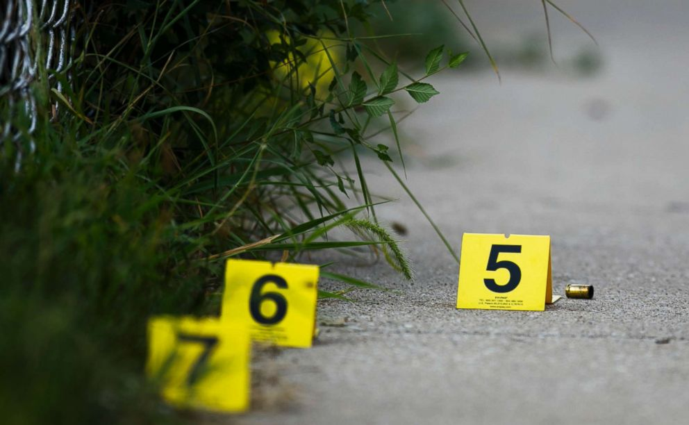 PHOTO: Evidence markers sit on the ground at the scene where a boy was killed after being shot in the abdomen while riding his bike in Chicago, Ill, Aug.5, 2018.