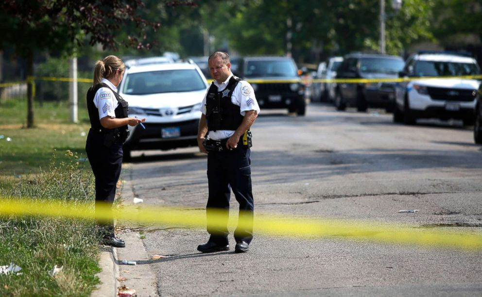 PHOTO: Chicago Police officers investigate a crime scene where a man was shot in the arm, August 12, 2018. According to statistics Chicago has more victims shootings and stabbings than both New York City and Los Angeles together.