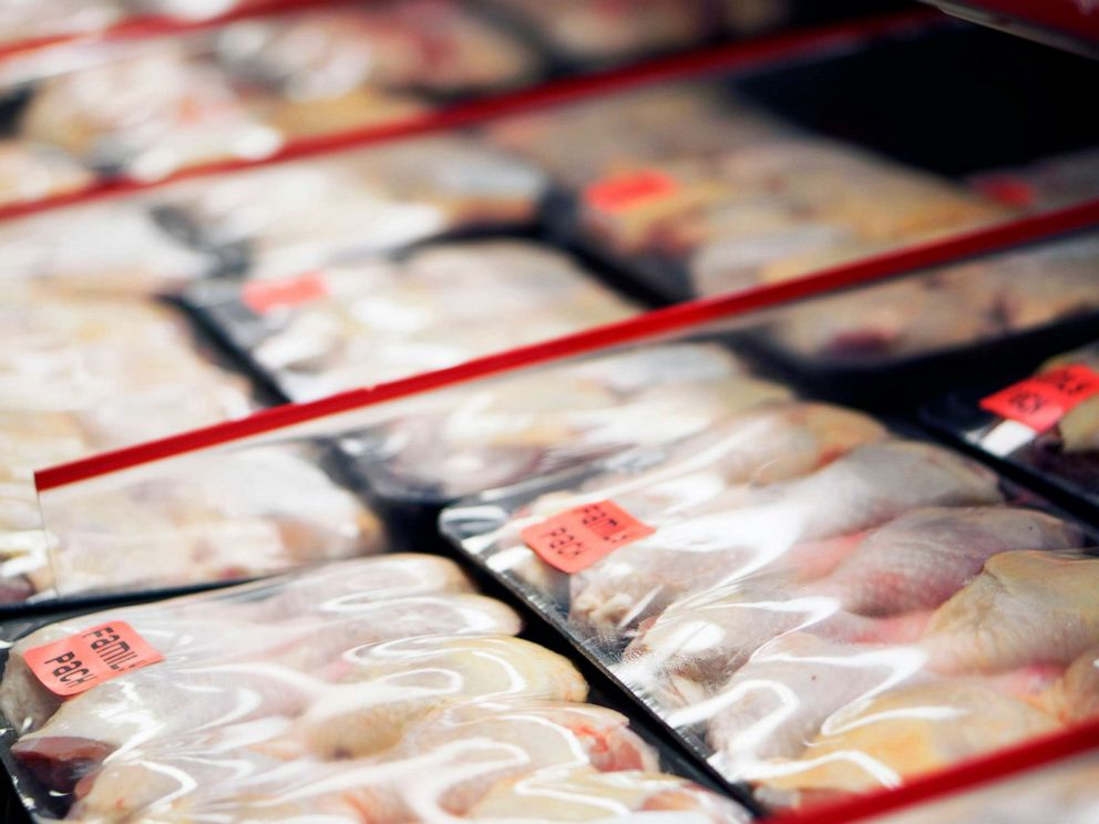 PHOTO: Packaged chicken legs in store refrigerator.