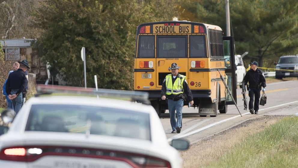 Emergency personnel respond to a scene of a collision that killed three children crossing the road as they were boarding their school bus north of Rochester, Ind., Oct. 30, 2018.