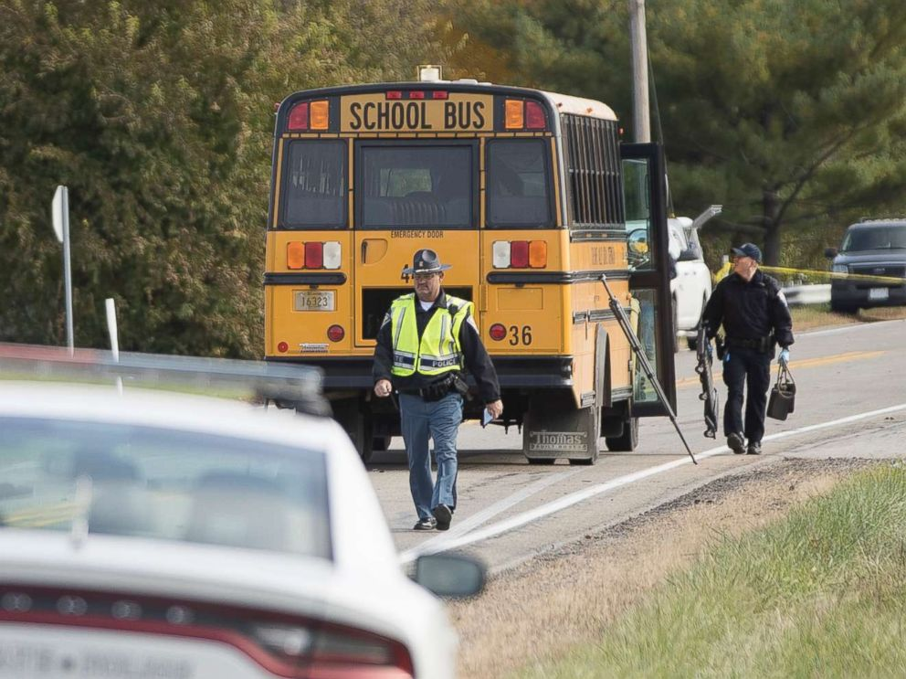 PHOTO: Emergency personnel respond to a scene of a collision that killed three children crossing the road as they were boarding their school bus north of Rochester, Ind., Oct. 30, 2018.
