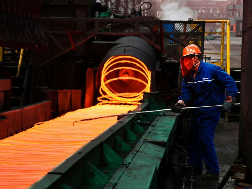 PHOTO: An employee sorts hot red steel at a steel plant in Zouping in Chinas eastern Shandong province on March 5, 2018.