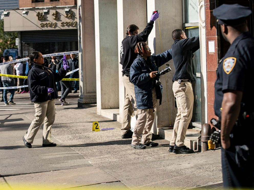 PHOTO: New York Police Department officers investigate the scene of an attack in Manhattans Chinatown neighborhood, Oct. 5, 2019, in New York.