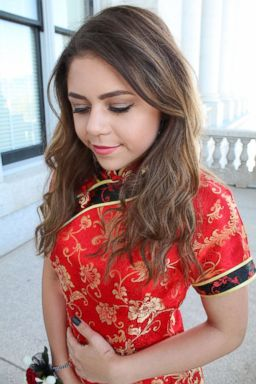 PHOTO: Keziah Daum, an 18-year-old senior at Woods Cross High School, Utah, is pictured in a red qipao, a traditional Chinese dress, on prom night.