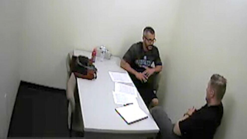 Chris Watts speaks with investigators after being arrested for the murder of his wife and two children in police surveillance released, Nov. 29, 2018.