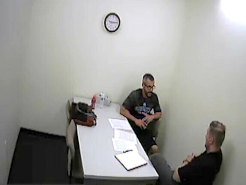 PHOTO: Chris Watts speaks with investigators after being arrested for the murder of his wife and two children in police surveillance released, Nov. 29, 2018.