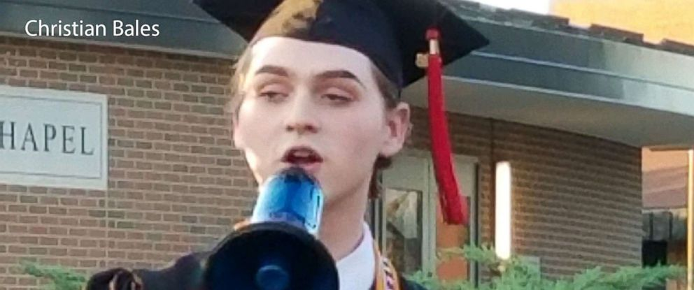 PHOTO: Holy Cross High Schools graduating valedictorian and student council president Christian Bales delivers his speech outside after the ceremony, May 25, 2018, in Covington, Ky.