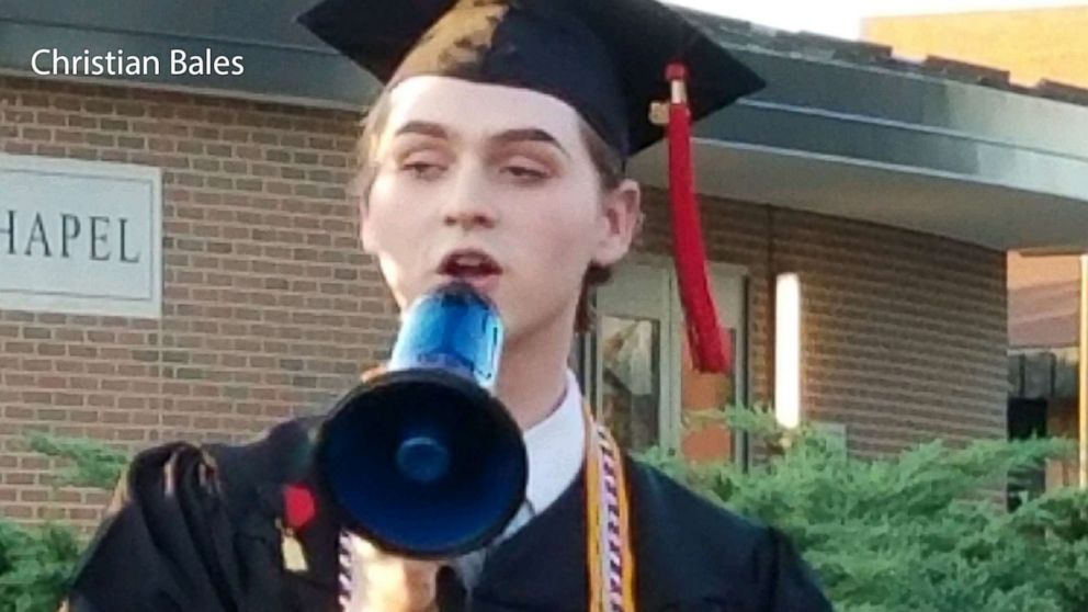 Holy Cross High School's graduating valedictorian and student council president Christian Bales delivers his speech outside after the ceremony, May 25, 2018, in Covington, Ky.
