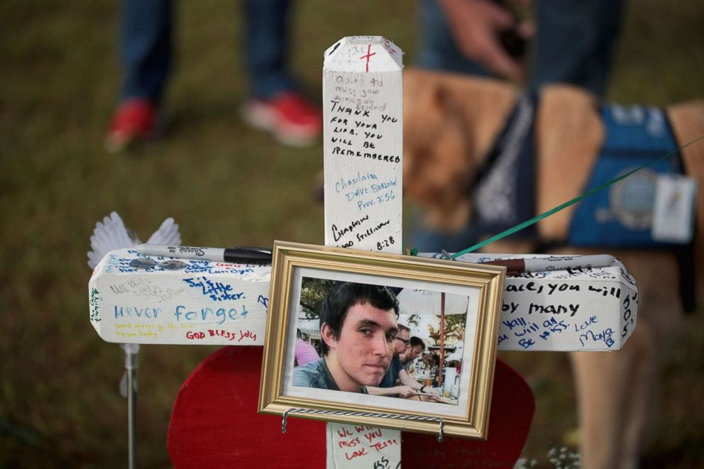 PHOTO: A photo of Christian Garcia hangs on a cross at a memorial in front of Santa Fe High School, May 22, 2018 in Santa Fe, Texas.