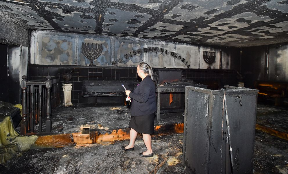 PHOTO: Elizabeth Collazo, the daughter of Pastor Carmen L. Cruz, walks through the badly damaged church following the fire at Iglesia Pentecostal De Bethlehem Church, April 23, 2019, in Allentown, Pa.