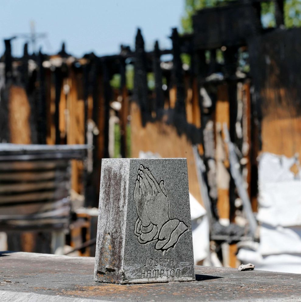 PHOTO: Graves from a cemetery are seen behind the burnt ruins of the Greater Union Baptist Church, one of three that recently burned down in St. Landry Parish, are seen in Opelousas, La., April 10, 2019.
