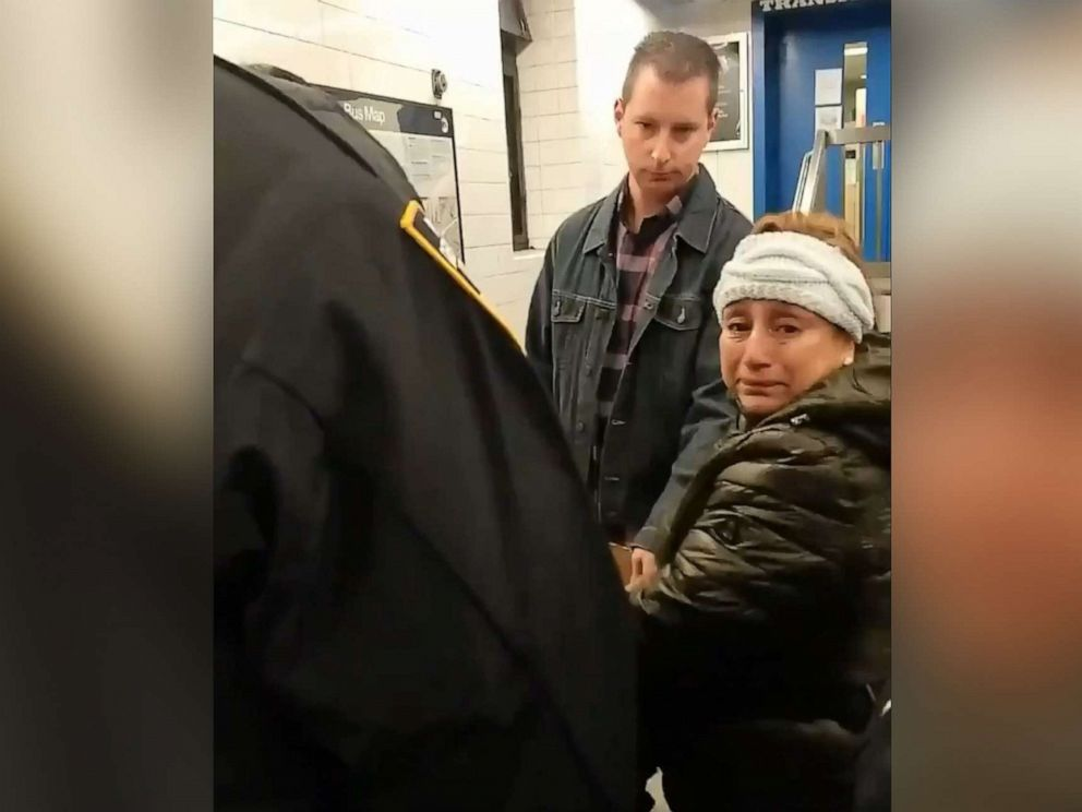 PHOTO: Police handcuff woman selling churros in Brooklyn subway station in New York, Nov. 9, 2019.