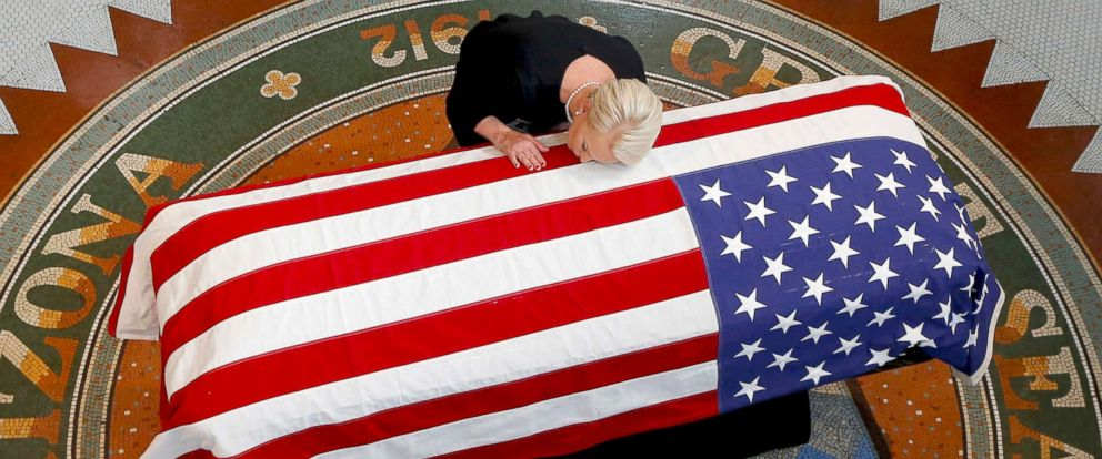 PHOTO: Cindy McCain, wife of Sen. John McCain, lays her head on the casket during a memorial service at the Arizona Capitol, Aug. 29, 2018, in Phoenix.