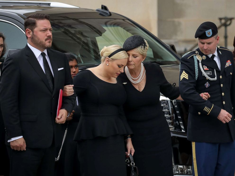PHOTO: Meghan McCain and her mother Cindy McCain embrace as the casket of the late Senator John McCain arrives at the Washington National Cathedral for the funeral service for McCain, Sept. 1, 2018, in Washington.