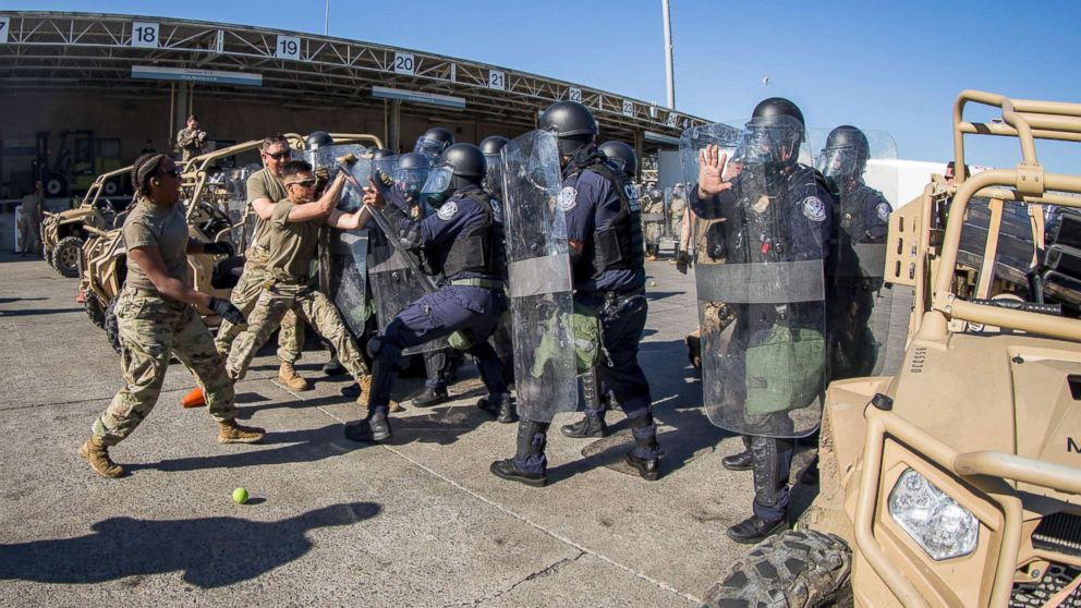 U.S. Soldiers with 93rd Military Police Battalion, Special Purpose Marine Air-Ground Task Force 7, simulate resistance during civil disturbance training with U.S. Customs and Border Protection (CBP) at the Otay Mesa Port of Entry, Dec. 16, 2018.