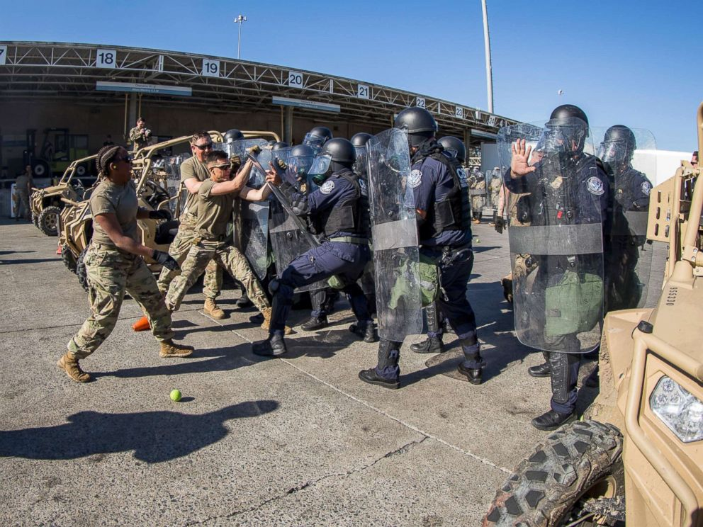 PHOTO: U.S. Soldiers with 93rd Military Police Battalion, Special Purpose Marine Air-Ground Task Force 7, simulate resistance during civil disturbance training with U.S. Customs and Border Protection (CBP) at the Otay Mesa Port of Entry, Dec. 16, 2018.