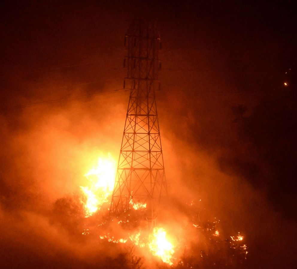 PHOTO: Heavy fire from the Thomas Fire burns around power line towers in Coyote Canyon near Montecito, Calif., Dec. 16, 2017.