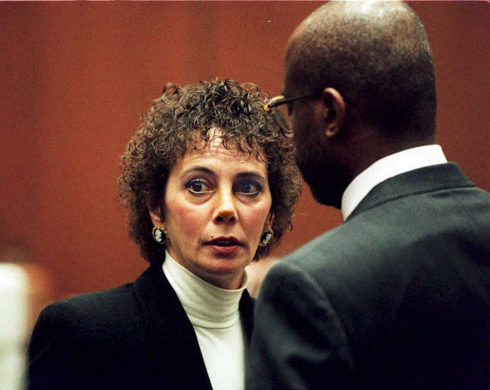 PHOTO: Lead prosecutor Marcia Clark (L) talks with fellow prosecutor Christopher Darden during court proceedings, Jan. 26, 1995, in Los Angeles.