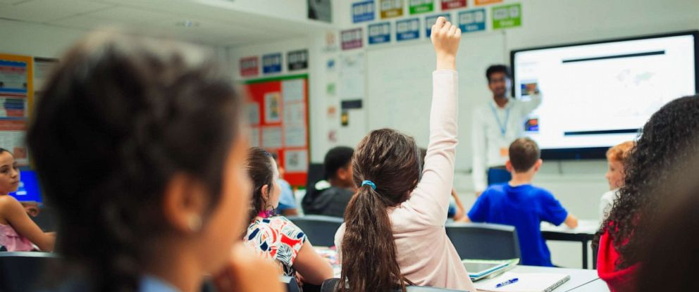 PHOTO: In this undated file photo, a junior high school student raises her hand and asks a question during a lesson in the classroom.