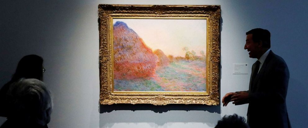 "PHOTO: The painting by Claude Monet, part of the Haystacks ""Les Meules"" series is displayed at Sothebys during a press preview of their upcoming impressionist and modern art sale in New York, May 3, 2019."