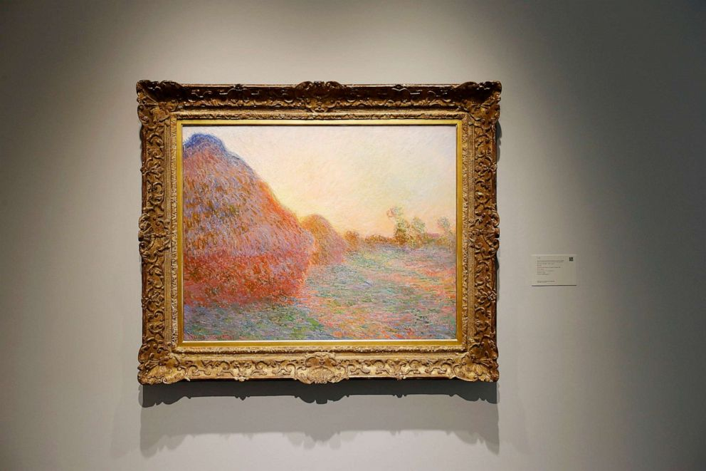 PHOTO: A painting entitled Meules by Claude Monet (1840-1926) is displayed during the unveiling of new public art galleries at Sothebys, May 3, 2019, in New York City.