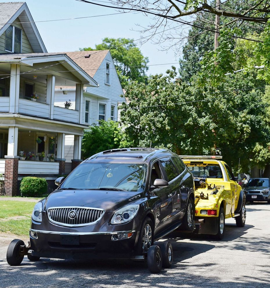 PHOTO: A vehicle is towed away from the crime scene where several bodies were found, July 9, 2019, in Cleveland.