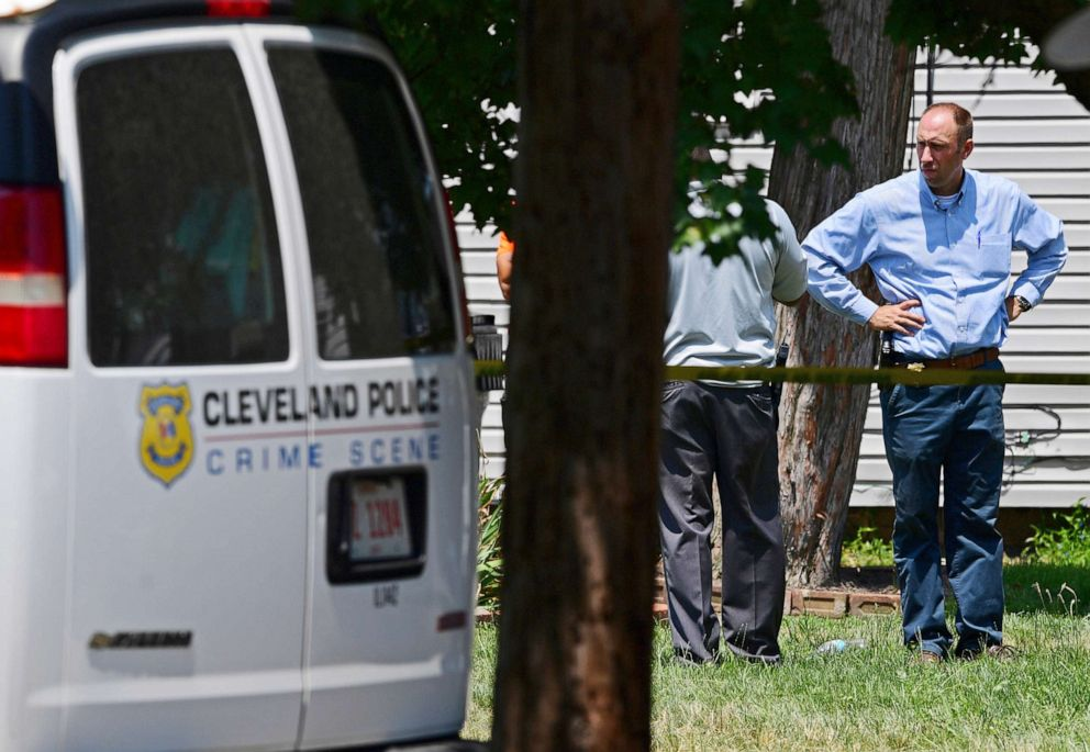 PHOTO: Police officers work at the scene where several bodies were found, Tuesday, July 9, 2019, in Cleveland.