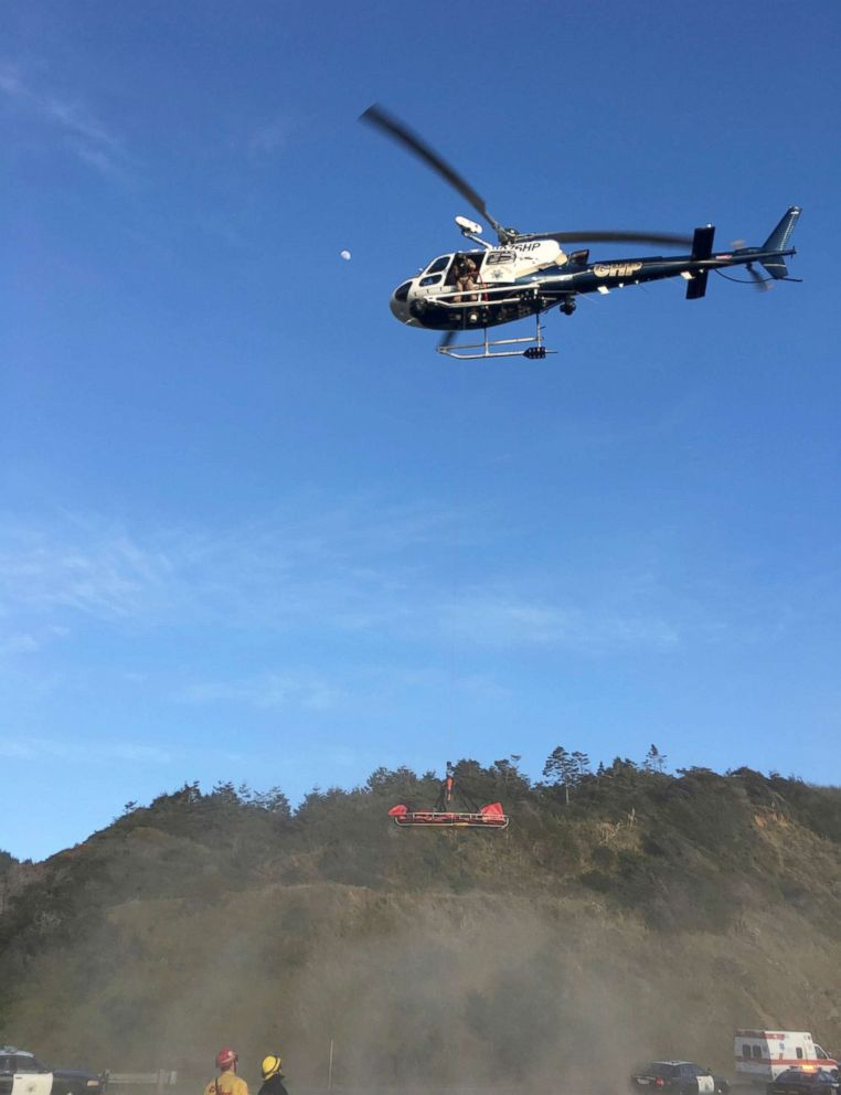 PHOTO: A helicopter hovers over the scene where a vehicle plunged off a cliff in Northern California near Mendocino, Calif., March 27, 2018.