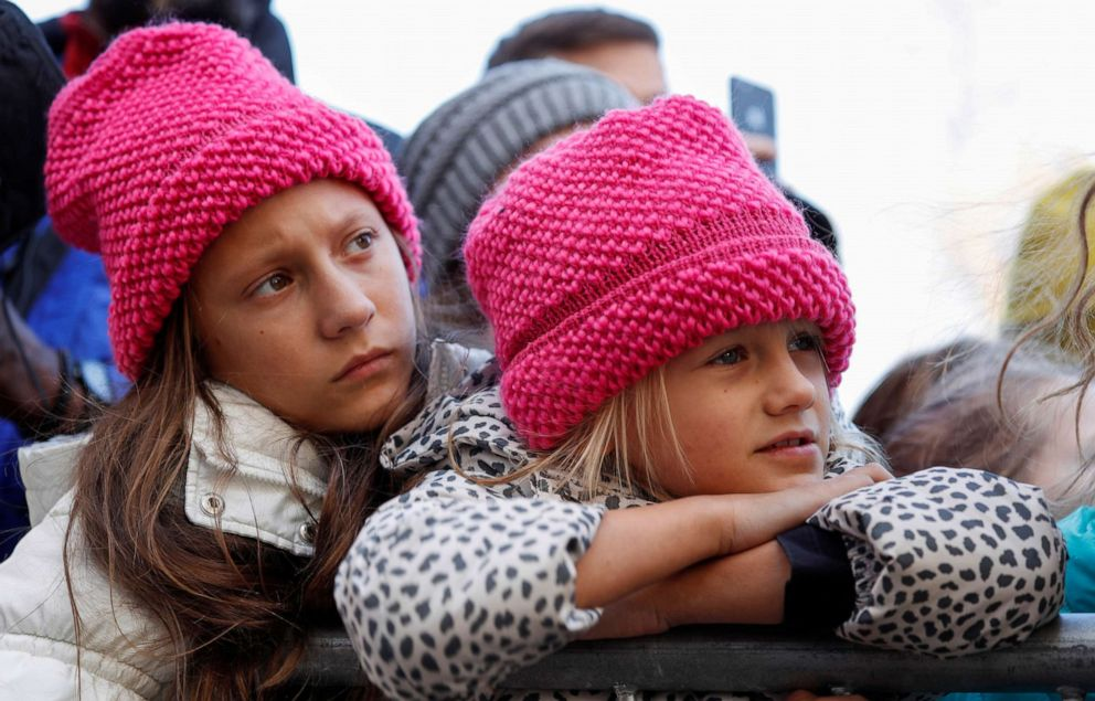 PHOTO: Two young girls listen as Swedish teen environmental activist Greta Thunberg leads a climate change rally in Charlotte, N.C., Nov. 8, 2019.