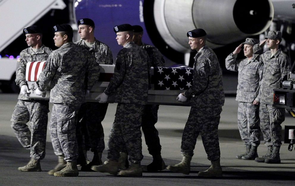 PHOTO: An Army carry team moves a transfer case containing the remains of Sgt. Clinton K. Ruiz, 22, at Dover Air Force Base, Del., Oct. 27, 2012.