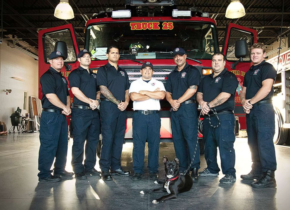 PHOTO: Clover is pictured with fire fighters at Madeira Beach Fire Station in Madeira Beach, Fla.