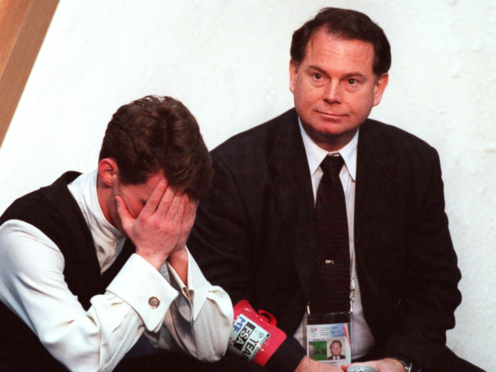 PHOTO: With coach Richard Callaghan at his side, American figure skater Todd Eldredge hangs his head as he waits for his scores following the finals of the mens figure skating competition at the 1998 Winter Olympics in Nagano, Japan.