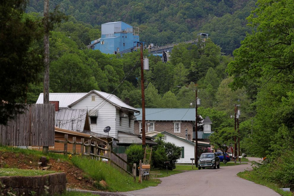 Coal camp company houses sit below the Lone Mountain Processing coal mine in St. Charles, Va., May 18, 2018.