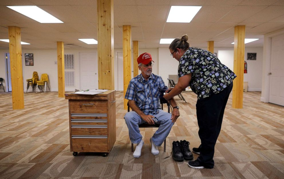 Nurse Melissa Muse checks the blood pressure of retired coal miner James Marcum, who has complicated black lung disease, during an exam at Stone Mountain Health Services in St. Charles, Va., May 18, 2018. Marcum worked at a surface strip mine for 20 to 25 years, but has not yet been approved for benefits for his black lung disease.