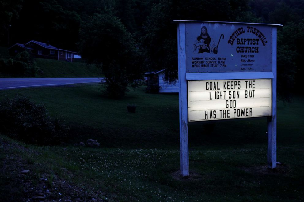 "The sign outside the Bethel Freewill Baptist Church reads ""Coal Keeps the Lights On But God Has the Power"" in Virgie, Ky., May 18, 2018."