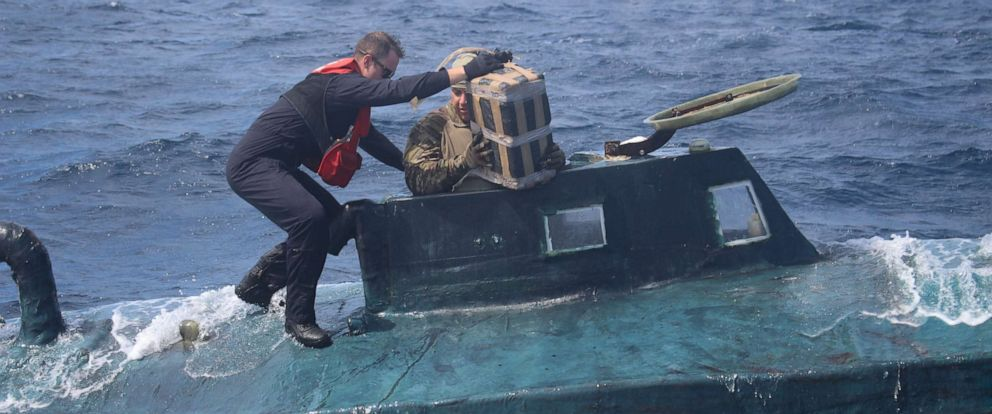 PHOTO: U.S. Coast Guard boarding team members climb aboard a suspected smuggling vessel in the Eastern Pacific in September 2019.