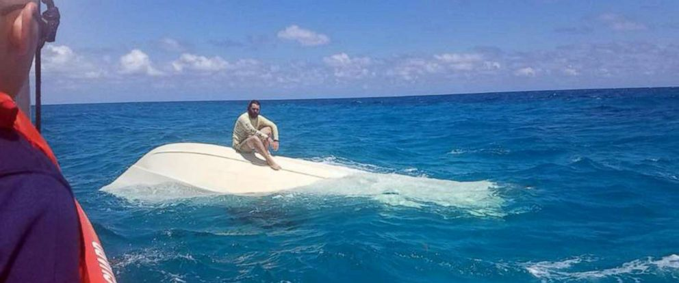 PHOTO: The U.S. Coast Guard Station Islamorada in Florida shared this image of a man sitting on a capsized vessel while waiting for rescue on April 7, 2018.