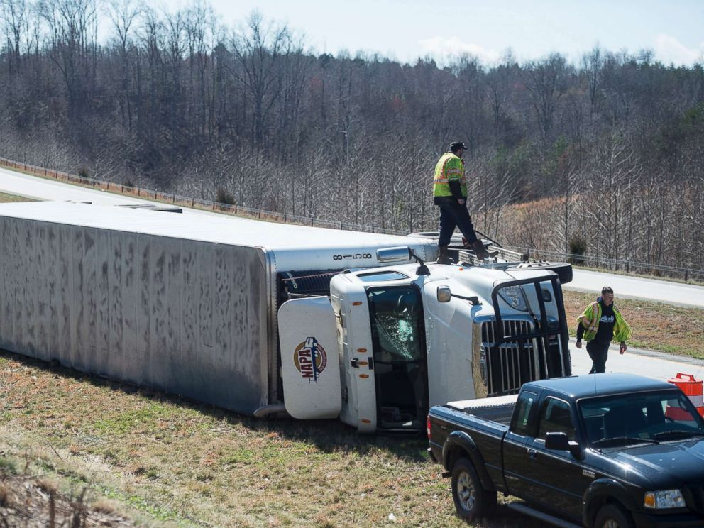 PHOTO: Fuel is siphoned from an overturned tractor-trailer on northbound 29 in Amhesrt, Va., March 2, 2018. Virginias coast is bracing for possible flooding in the wake of the noreaster that slammed into the East Coast.