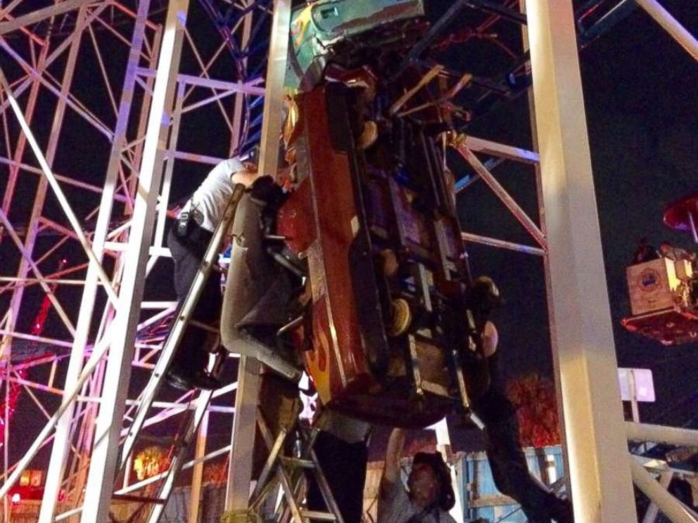 Firefighters in Daytona Beach, Florida, were called in to rescue 10 people trapped on a derailed roller coaster.